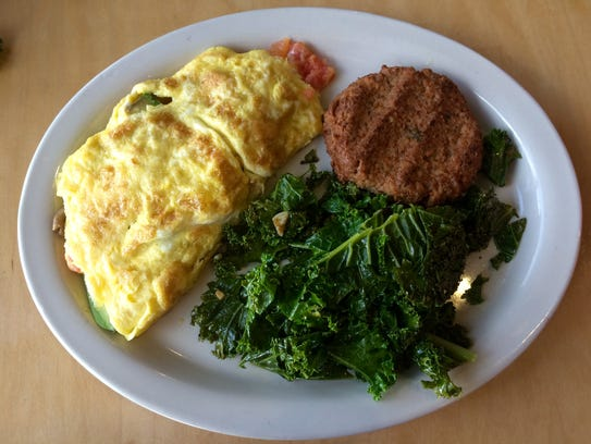An omelette with kale and vegetarian pecan sausage