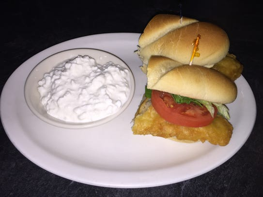 A fish sandwich with cottage cheese at Shakespeare's
