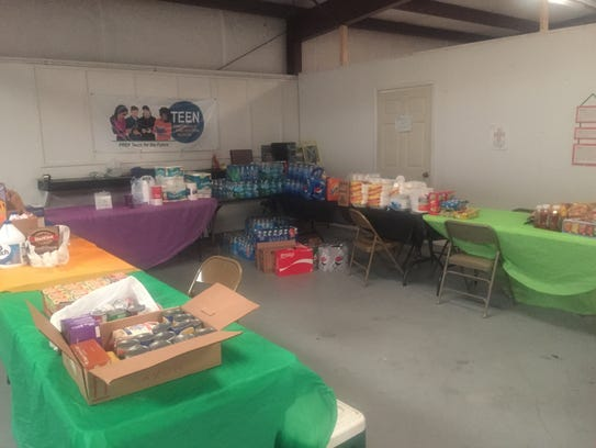Donated food and supplies for storm victims at Life