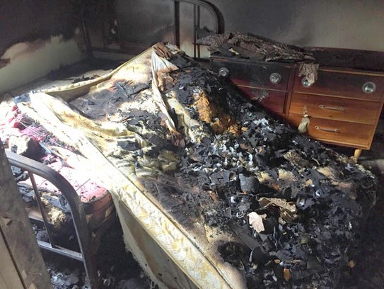 A mattress is charred after an incident saw something