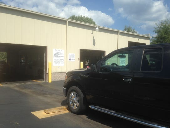 In this 2016 file photo, the driver of a pickup waits to go through an emission test in Murfreesboro.
