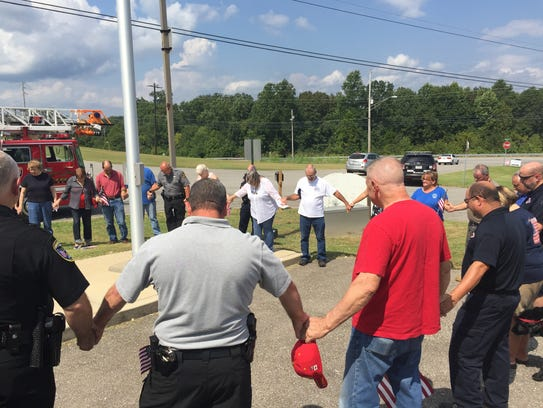 Stewart County residents and first responders bow their