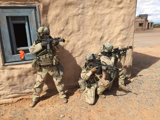 Soldiers from 1-36 Infantry conduct an urban assault