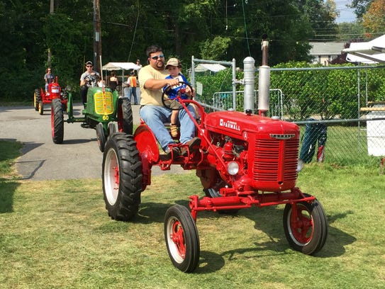 Visitors to the 92nd annual Grange fair in Yorktown