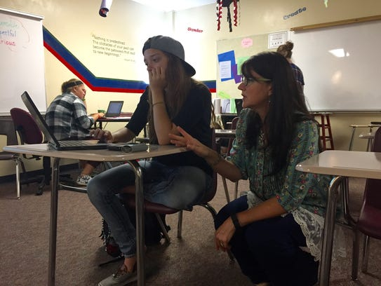 Neenah High School teacher Tara Rockweit helps Brittney