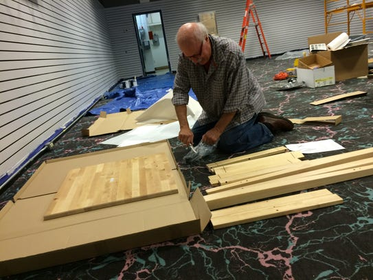 Jim Harris puts together one of several tables he'll
