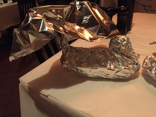 Leftovers become aluminum foil swans at Rosalie's Cucina.