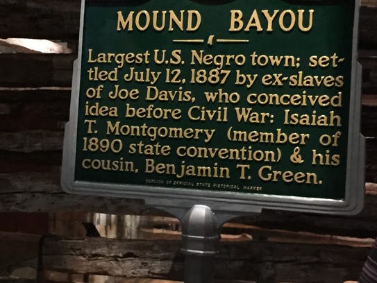 A sign describing the history of Mound Bayou is one