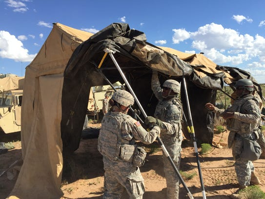 Soldiers from Alpha Company, 86th ESB put up a command-post