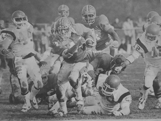 Middletown North's Pat Toland rumbles for yardage in