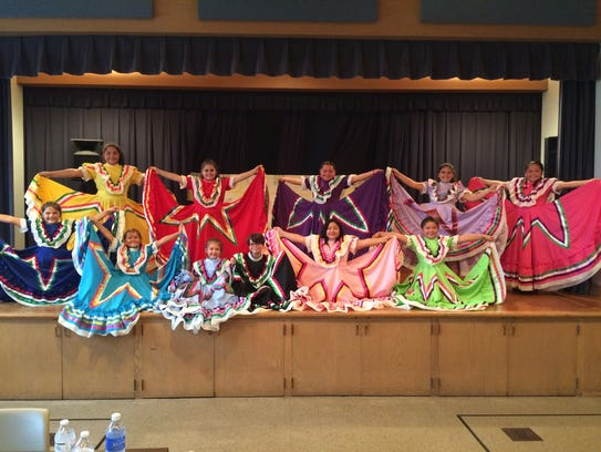 Members of the Mi Pueblo Ballet Folklorico group gathered
