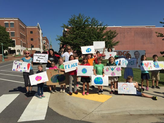 Amare Montessori students rallying for peace in Downtown