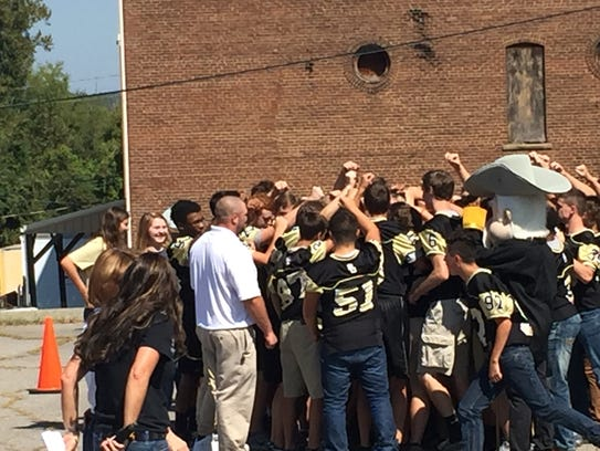 The Rebel football team shows their unity.