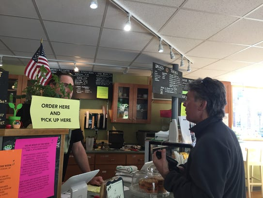 Left, co-owner of the Coffee Liberation Front Christopher