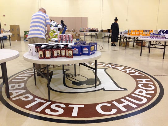Volunteers stock food at the Whitely Community Council's
