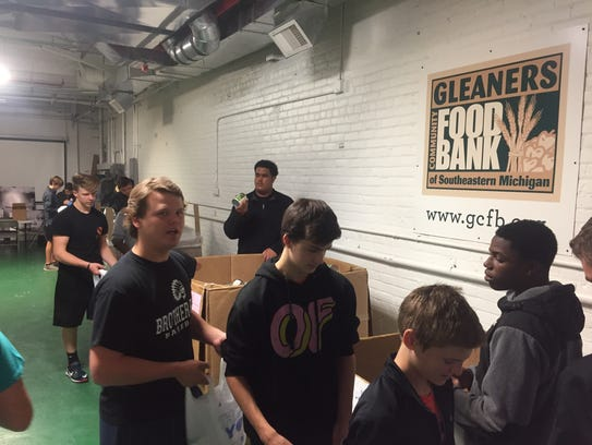 Brother Rice students help pack food at Gleaners.