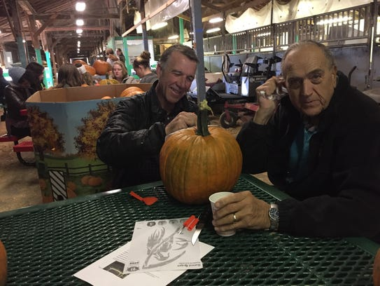 Republican nominee for governor Phil Scott carves a