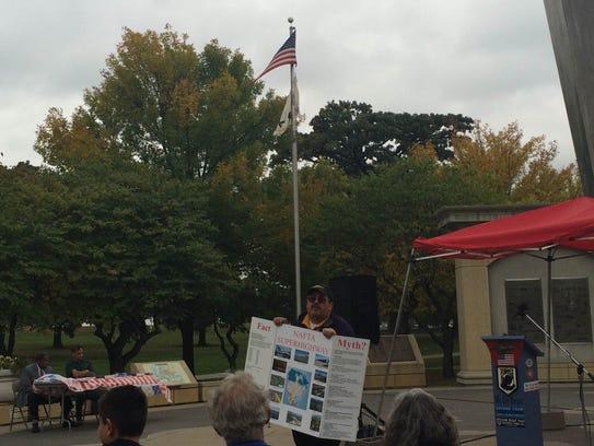 Iowa Minutemen director Robert Ussery speaks at the