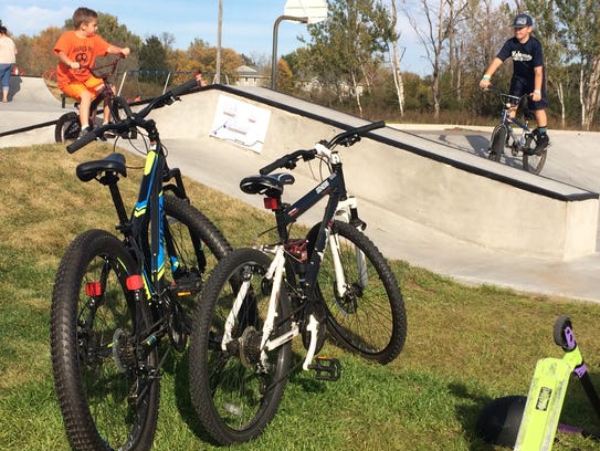 Kids rode their bikes at the Nekoosa skate park to