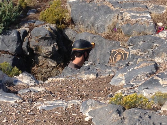 Actor xxxx looks at the memorial for St. George native
