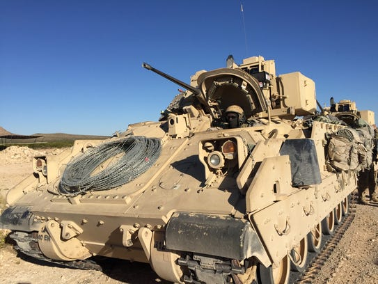 A Bradley Fighting Vehicle gets ready to roll out during