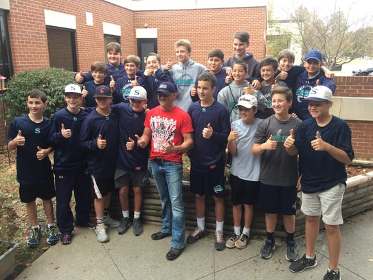 Rising country star Ryan Weaver, center, stands with