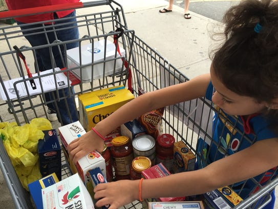 A 2015 food collected items for People to People outside