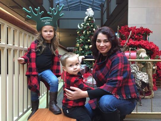 Jenn Adams of Williston posed with her children just