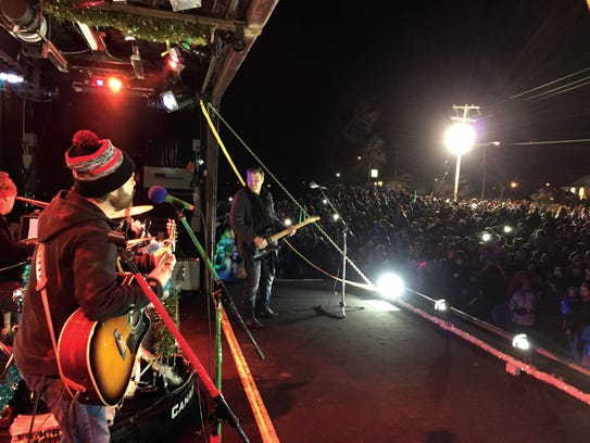 A band rocks on during the holiday train stop.