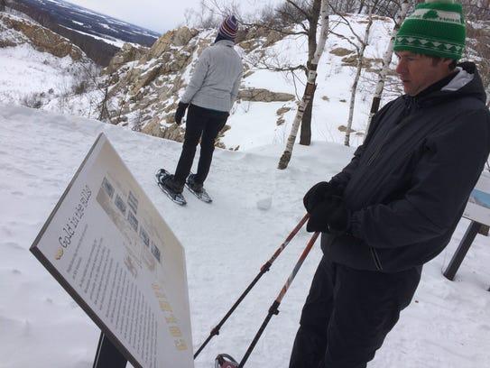 Snowshoers explore Rib Mountain.