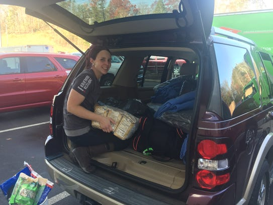 JJ Blevins, a rescue worker, unloads supplies in Gatlinburg.