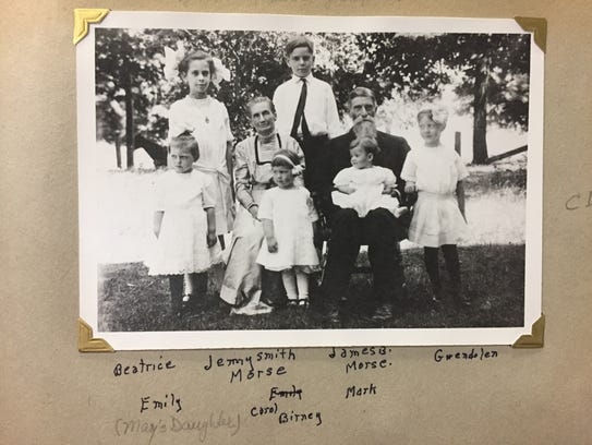 Grandma and Grandpa surrounded by six grandchildren.