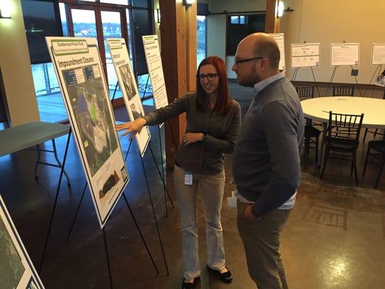 TVA Project Manager Ashley Pilakowski, left, explains