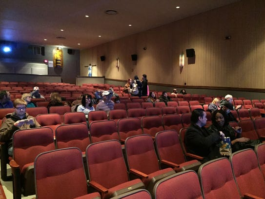 Friends, family and moviegoers take their seats for