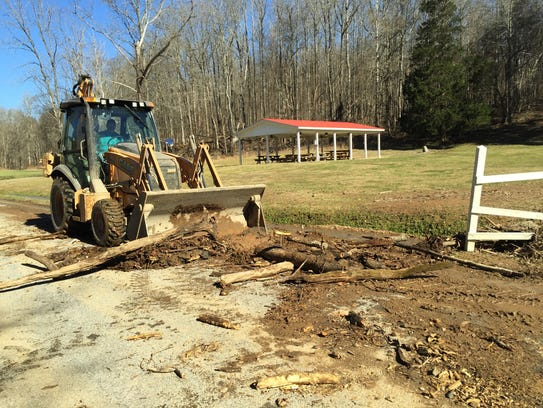 The Stewart County Highway Department clears flood
