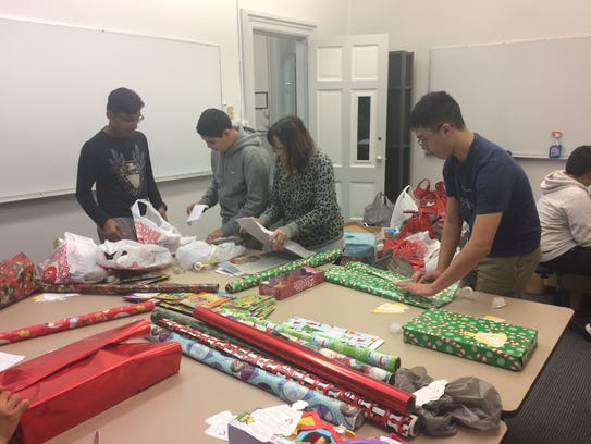 St. Lawrence Seminary sophomores wrap gifts as part
