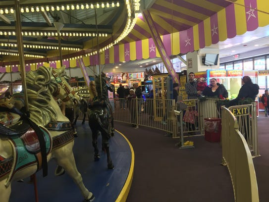 A line forms to ride the carousel at the Casino Pier