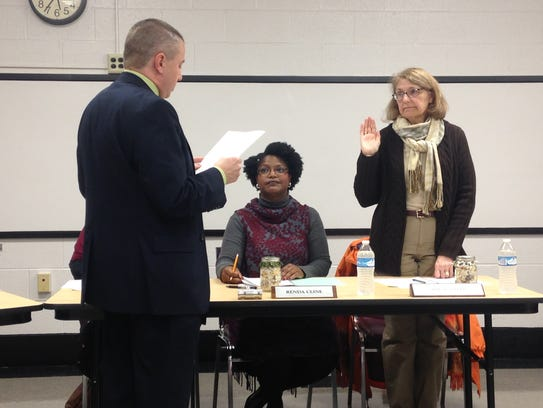 Newly reappointed board president Renda Cline looks
