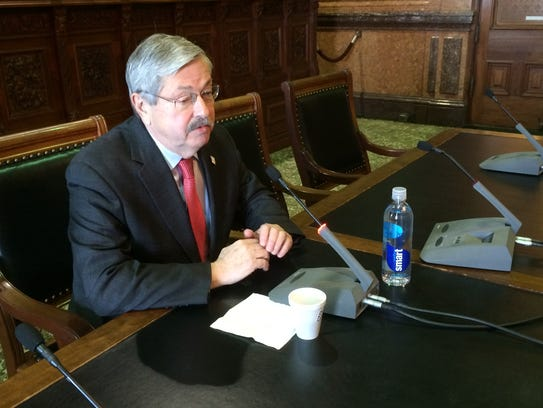 Gov. Terry Branstad talks with reporters at the State