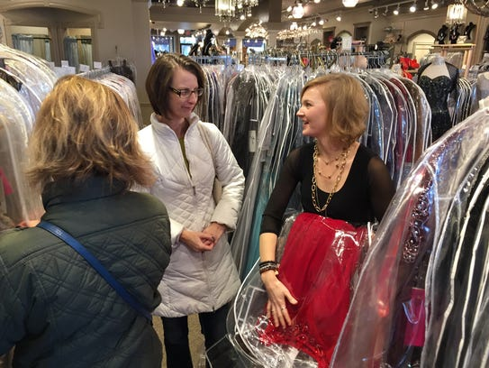 Clothing Cove sales manager Kelly Achino assists neighbors