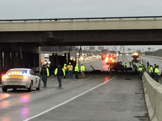 INDOT and law enforcement officials inspect the damaged