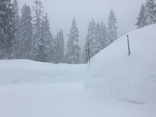 Snow banks on the road leading into Crater Lake National