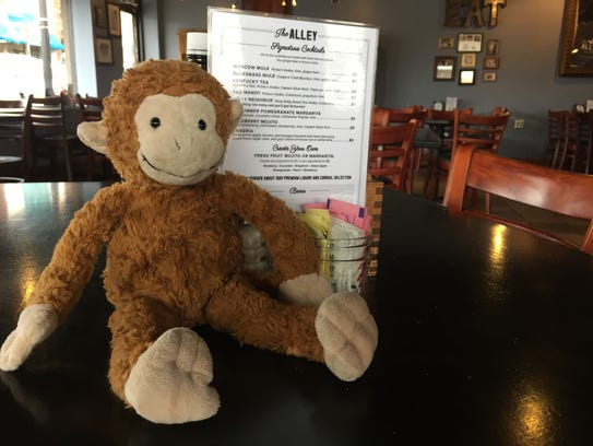 This Curious George toy was left by a patron's young