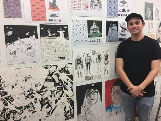 Senior Sam Zarnowski stands near some of his work at