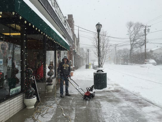 Ernie Garbaccio clears the sidewalk in front of his