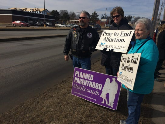 About 50 people protested against federal funding of
