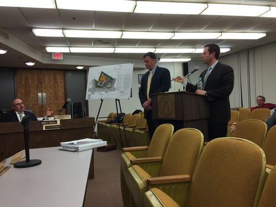 Attorney Jason Tuvel (right), representing the company