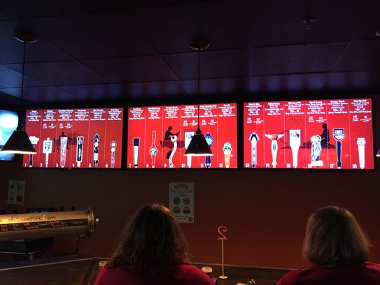 A lighted board lets customers at The Growler Garage