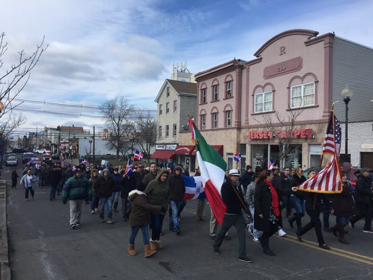 A march down Smith Street in Perth Amboy on Thursday