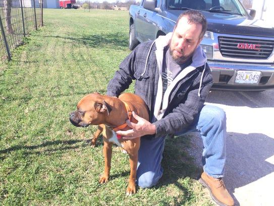 Dan Kilmer holds Chubbs, who he obtained through a